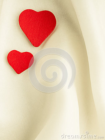 Free Red Wooden Decorative Hearts On White Silk Background. Royalty Free Stock Photo - 36512575