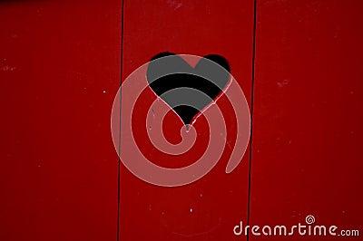 Red wooden door with heart