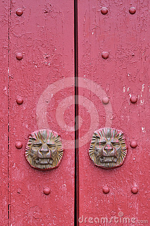 Red wooden door in traditional style