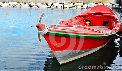 Red Wooden Fishing Boat Floating