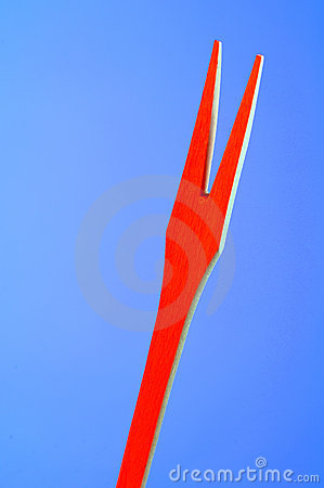 Red Wooden Fork on Blue Background