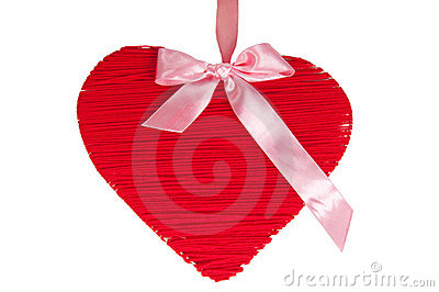 Red wooden heart with silk pink bow isolated