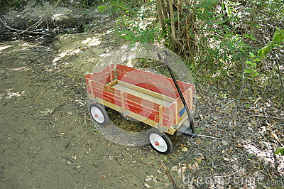 Red wooden wagon in the woods, Boise Greenbelt