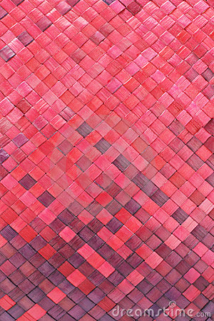 Red woven palm leaves mat