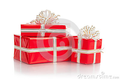 Red wrapped gift with a bow on a white background