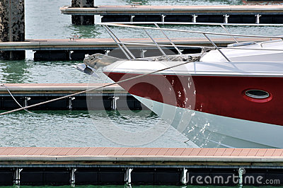 Red yacht in harbor