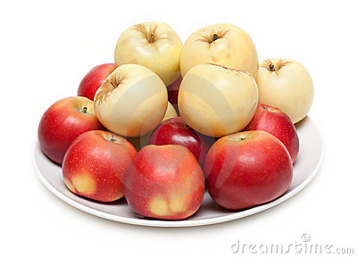 Red and yellow apple on plate