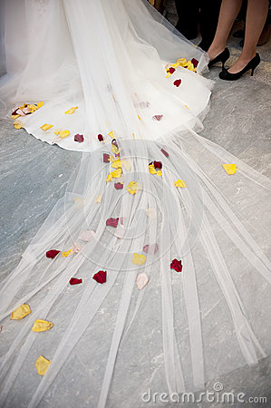 Red and yellow flowers in a white wedding dress