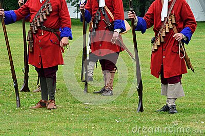 Redcoats with rifles standing to attention