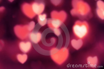 Reddish-pink lights as out-of-focus hearts