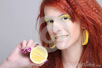 Redhaired woman with lemon earrings