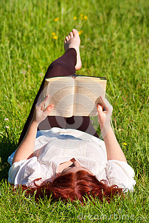 Free Redhead Beautiful Girl Reading A Book In Nature Royalty Free Stock Image - 25047916