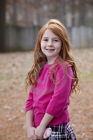 Redhead child outdoors