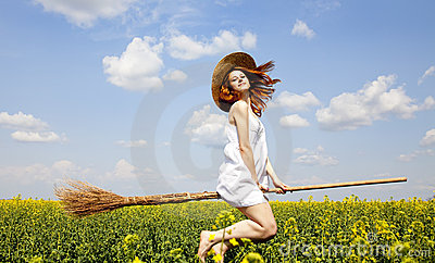 Redhead enchantress fly over spring rapeseed field