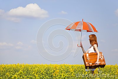 Redhead enchantress with umbrella