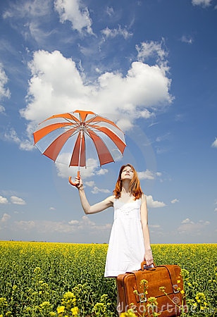 Redhead enchantress with umbrella