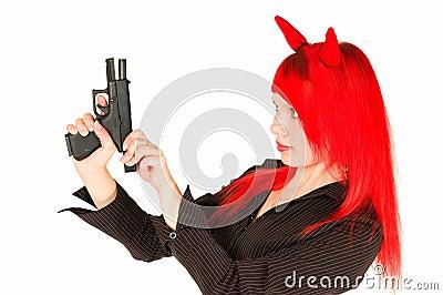Redhead girl charging a gun
