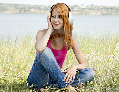 Redhead girl with headphone