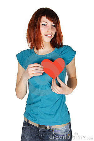 Redhead girl holding red paper heart on her breast