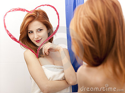 Redhead girl near mirror