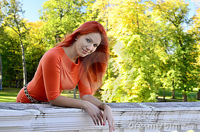 Redhead girl at the railing