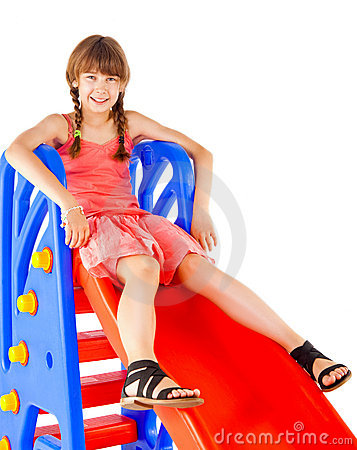 Redhead girl on slide
