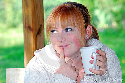 Redhead girl with white cup