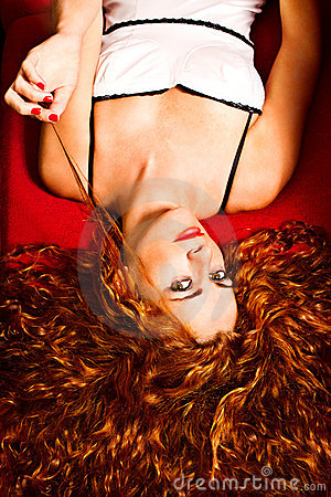 Free Redhead On The Red Couch Royalty Free Stock Images - 15826029