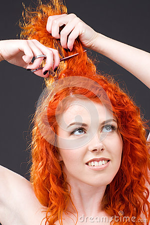 Redhead with scissors
