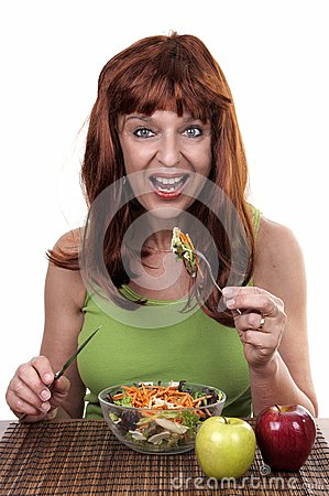 Redhead woman eating
