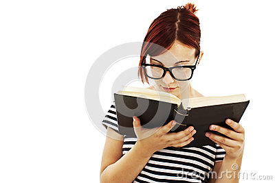 Redhead woman with glasses reading a book