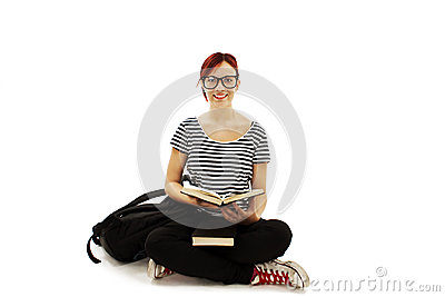 Redhead woman with glasses studying