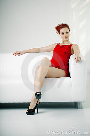 Free Redhead Woman In A Red Dress On White Couch Stock Photography - 21873972