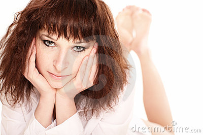 Redhead woman lying barefoot