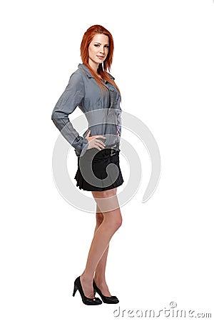 Redhead woman standing in studio