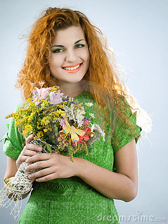 Redheaded girl with bouquet