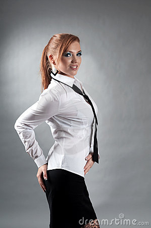 Redheaded girl  in formal dress  white shirt