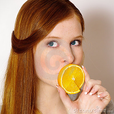 Redheaded  girl with orange