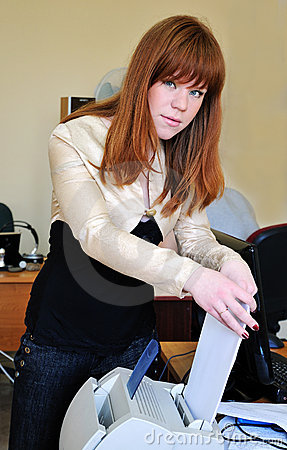 Redheaded girl using printer