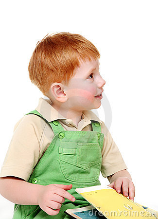 Redheaded kid with book