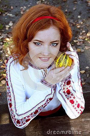 Redheaded Ukraininan girl sitting at the table