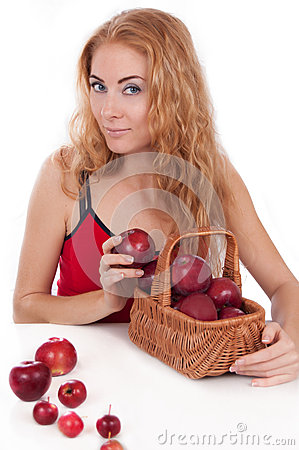 Redheaded woman with basket of apples