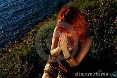 Redheaded woman praying