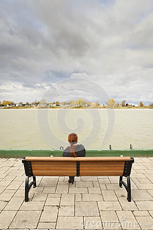 Woman looking at river