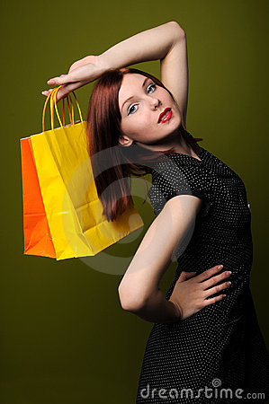 Redheaded Woman With Shopping Bags