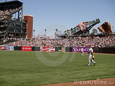 Reds outfield walk to positions between plays Editorial Image