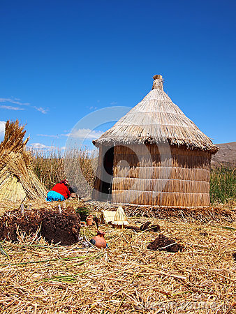 Reed hut on the floating Uros islands Editorial Stock Photo