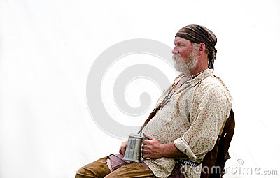 Reenactor listening to stories with a mug Editorial Stock Image