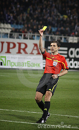 Referee shows the yellow card Editorial Stock Image