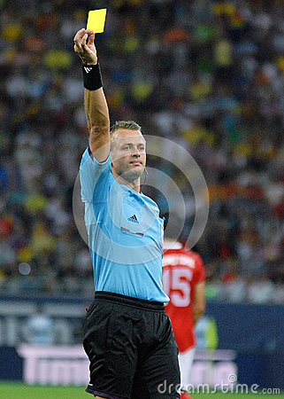 Referee Svein Oddvar Moen shows a yellow card in Romania-Turkey World Cup Qualifier Game Editorial Photo